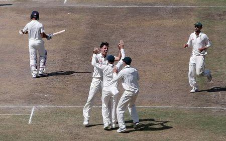Cricket - India v Australia - Third Test cricket match - Jharkhand State Cricket Association Stadium, Ranchi, India - 18/03/17 - Australia's Pat Cummins celebrates with his teammates after dismissing India's Ajinkya Rahane. REUTERS/Adnan Abidi