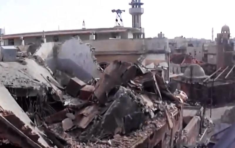 This image taken from video obtained from the Shaam News Network, which has been authenticated based on its contents and other AP reporting on Wednesday, Oct. 10, 2012, shows a destroyed building from shelling in Homs, Syria, on Monday, Oct. 8, 2012. (AP Photo/Shaam News Network via AP video)