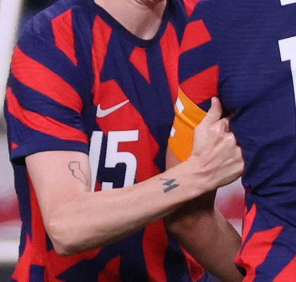 <p>The outline of California can be spotted on Rapinoe's right bicep. The tattoo represents her hometown of Redding, CA.</p>