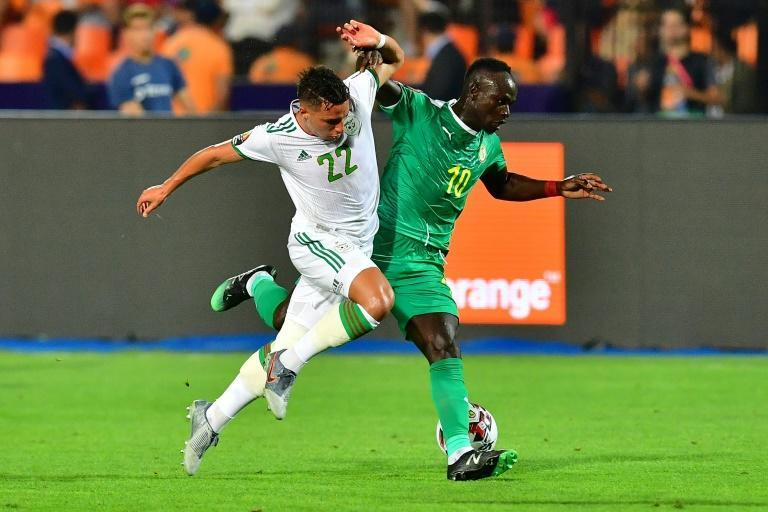 Sadio Mane (R) scored the goal that qualified Senegal for the 2021 Africa Cup of Nations