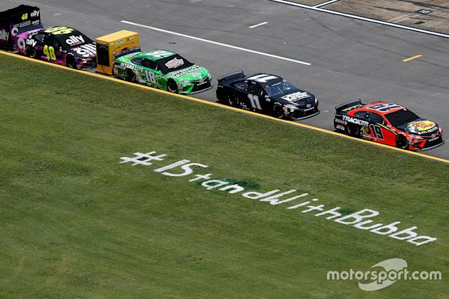 """A view of pit road is seen with an #IStandWithBubba stencil painted on the grass <span class=""""copyright"""">NASCAR Media</span>"""
