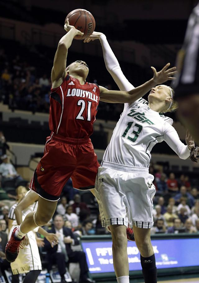 South Florida guard Inga Orekhova (13) blocks a shot by Louisville guard Bria Smith (21) during the first half of an NCAA college basketball game on Sunday, Jan. 12, 2014, in Tampa, Fla. (AP Photo/Chris O'Meara)