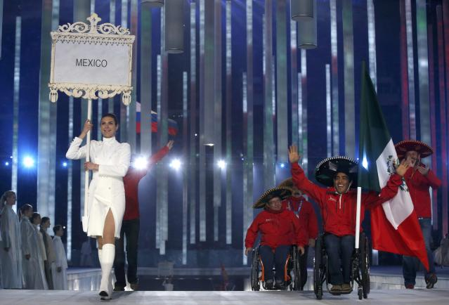 Mexico's flag-bearer Arly Velasquez (2nd R), leads his country's contingent during the opening ceremony of the 2014 Paralympic Winter Games in Sochi, March 7, 2014. REUTERS/Alexander Demianchuk (RUSSIA - Tags: OLYMPICS SPORT)