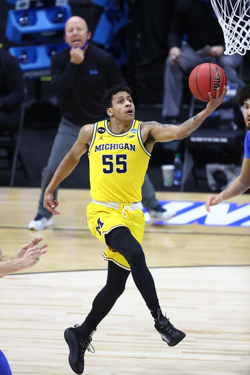 Michigan guard Eli Brooks goes up for a layup during the first half of an Elite Eight game in the NCAA tournament on Tuesday, March 30, 2021, in Indianapolis.