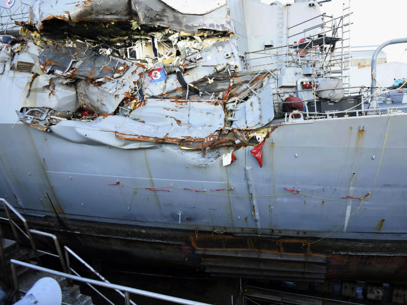 FILE - This July 11, 2017, file photo provided by the U.S. Navy shows the USS Fitzgerald in dry dock in Yokosuka, Japan, for repairs and assessment of damage sustained from a June 17 collision with a cargo ship in the waters off of Japan. Survivors and descendants of those killed when a container ship collided with the U.S. Navy destroyer off Japan's coast are suing the ship's Japanese charterer, according to a lawsuit filed Monday, Nov. 18, 2019, that details the survivors' scramble for safety as water rushed in. (Spc. 1st Class Leonard Adams/U.S. Navy via AP)