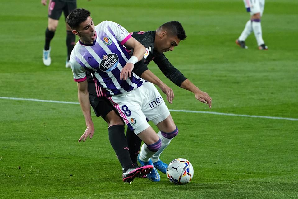 Real Valladolid's Spanish midfielder Kike Perez (L) vies with Real Madrid's Brazilian midfielder Casemiro during the Spanish league football match between Real Valladolid FC and Real Madrid CF at the Jose Zorilla stadium in Valladolid on February 20, 2021. (Photo by Cesar Manso / AFP) (Photo by CESAR MANSO/AFP via Getty Images)