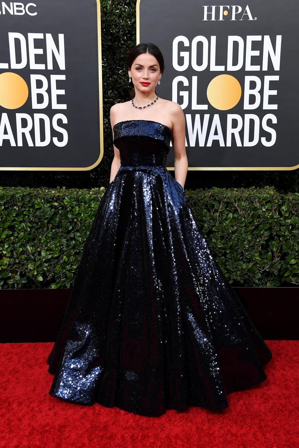 """Best of the night? The standout star of """"Knives Out"""" has absolutely nailed red carpet glam in this gorgeous Ralph Russo blue sequined, midnight blue gown. And it looks like it has pockets?! Perfection."""