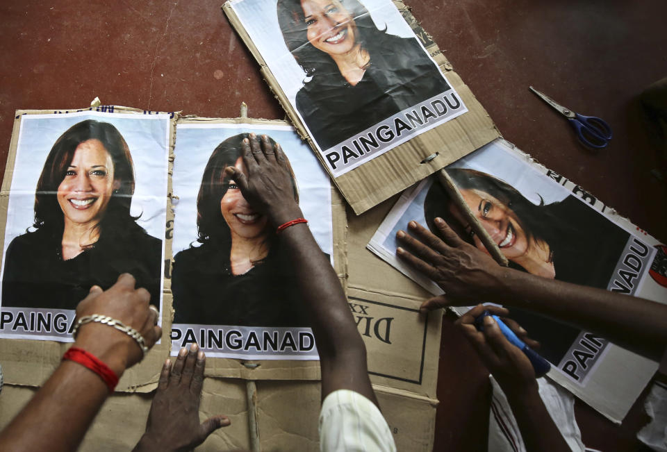 FILE - In this Nov. 6, 2020, file photo, villagers prepare placards featuring U.S. democratic vice presidential candidate Sen. Kamala Harris, as they prepare to celebrate should the Democratic Party win the presidential elections, in Painganadu a neighboring village of Thulasendrapuram, south of Chennai, Tamil Nadu state, India. Harris made history Saturday, Nov. 7, as the first Black woman elected as vice president of the United States, shattering barriers that have kept men — almost all of them white — entrenched at the highest levels of American politics for more than two centuries. (AP Photo/Aijaz Rahi, File)