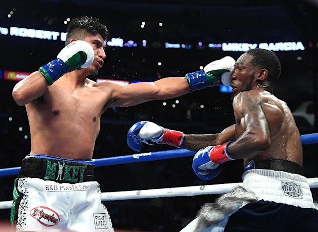 Mikey Garcia (L) retained his WBC title and grabbed Robert Easter's IBF belt with a unanimous decision victory at Staples Center arena (AFP Photo/Jayne Kamin-Oncea)