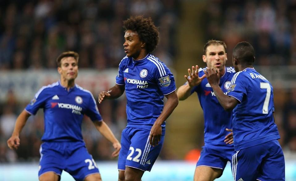 Chelsea's Willian (2nd L) celebrates after scoring a second goal during their English Premier League match against Newcastle, at St James' Park in Newcastle-upon-Tyne, on September 26, 2015 (AFP Photo/Ian MacNicol)