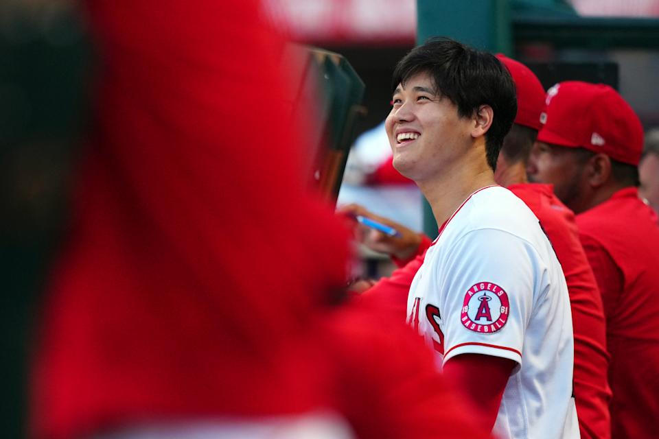 ANAHEIM, CA - JULY 05:  Shohei Ohtani #17 of the Los Angeles Angels smiles in the dugout during the game between the Boston Red Sox and the Los Angeles Angels at Angel Stadium on Monday, July 5, 2021 in Anaheim, California. (Photo by Daniel Shirey/MLB Photos via Getty Images)