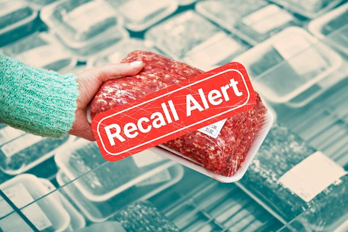 woman picking up a package of ground beef with a recall button over it
