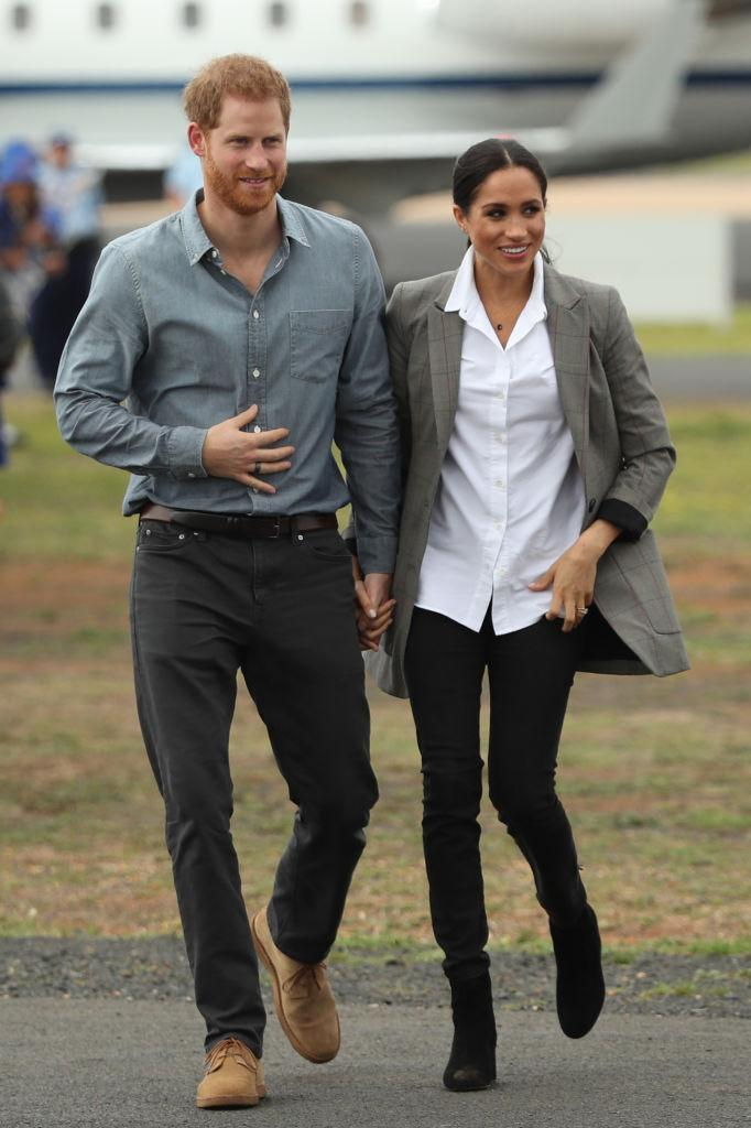 <p>On day two of the Duke and Duchess of Sussex's Australian royal tour, Meghan suited up. The Duchess wore a £110 'Boss' jacket by close friend and sportswoman Serena Williams, a shirt by Maison Kitsune and J. Crew ankle boots. In a dipomatic move, she finished the ensemble with a pair of 'Harriet' jeans from Aussie label Outland Denim. <em>[Photo: Getty]</em> </p>