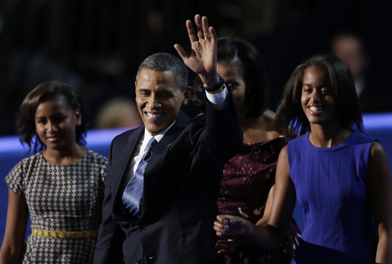 President Barack Obama waves with his wife Michelle and his daughters Malia and Sasha after his speech to the Democratic National Convention in Charlotte, N.C., on Thursday, Sept. 6, 2012. (AP Photo/Lynne Sladky)
