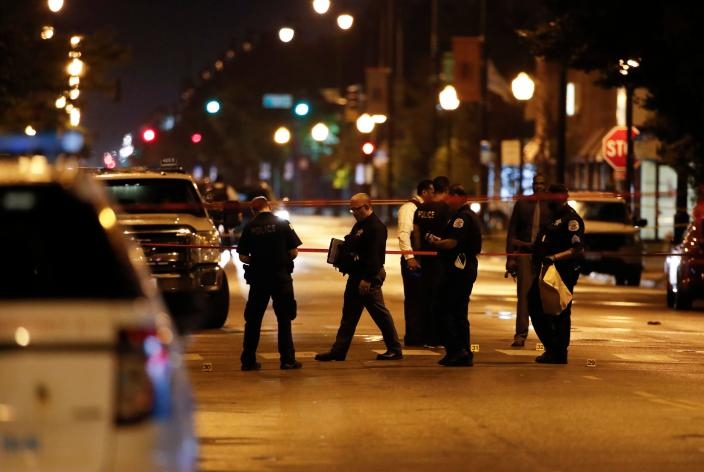 A shootout outside a funeral home in Chicago left 14 people wounded on Tuesday. (Kamil Krzaczynski/AFP via Getty Images)