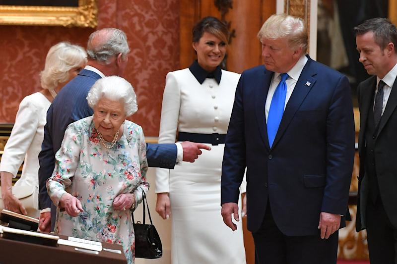 Britain's Queen Elizabeth II (L) views a display of US items of the Royal collection with US President Donald Trump and US First Lady Melania Trump at Buckingham palace at Buckingham Palace in central London on June 3, 2019, on the first day of their three-day State Visit to the UK. - Britain rolled out the red carpet for US President Donald Trump on June 3 as he arrived in Britain for a state visit already overshadowed by his outspoken remarks on Brexit. (Photo by MANDEL NGAN / AFP) (Photo credit should read MANDEL NGAN/AFP/Getty Images)