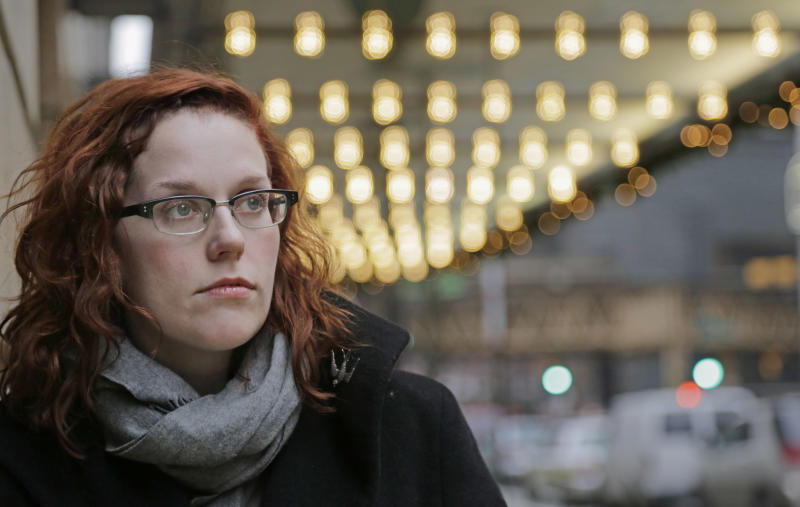FILE - In this Dec. 3, 2013 photo, actor Adrienne Matzen poses in Chicago's theater district. Matzen, 29, who has been mostly uninsured since she turned 21, is now looking for a low monthly premium insurance plan on the federal website. High deductibles for health plans available on the Illinois insurance exchange may contribute to sticker shock when people start paying medical bills in 2014, if they have elected to pay for insurance under the Affordable Care Act. (AP Photo/M. Spencer Green, File)