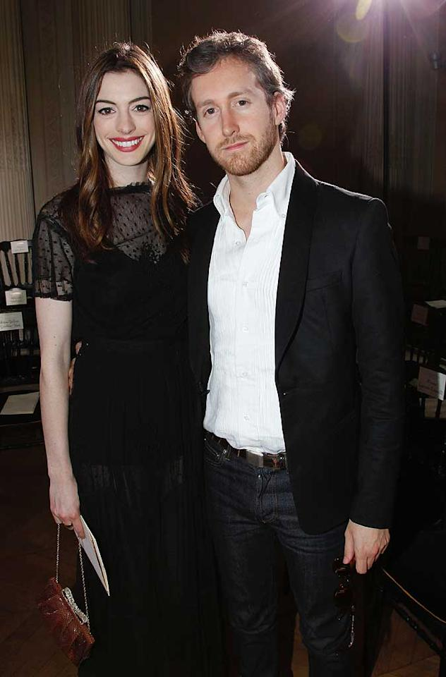"""Anne Hathaway was all smiles with her boyfriend, Adam Shulman, at the Valentino Haute Couture show on Wednesday. The """"Love and Other Drugs"""" actress donned a daring sheer black frock from her fave designer. Eric Ryan/<a href=""""http://www.gettyimages.com/"""" target=""""new"""">GettyImages.com</a> - July 6, 2011"""
