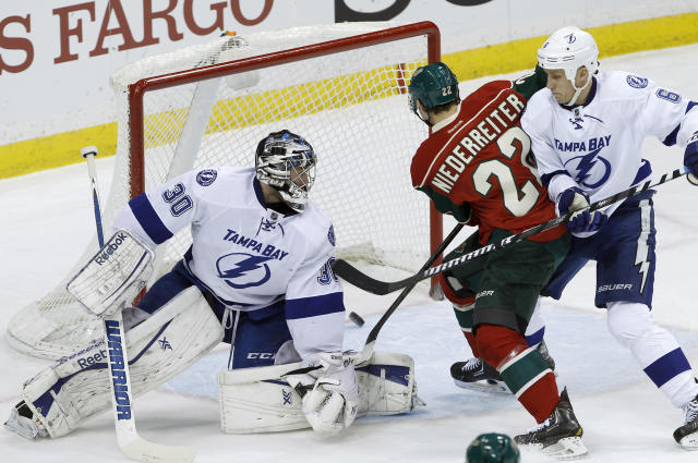 Minnesota Wild right wing Nino Niederreiter (22), of Switzerland, scores on Tampa Bay Lightning goalie Ben Bishop (30) as Lightning defenseman Sami Salo (6), of Finland, tries to stop him during the first period of an NHL hockey game in St. Paul, Minn., Tuesday, Feb. 4, 2014. (AP Photo/Ann Heisenfelt)