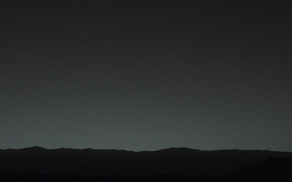This view of the twilight sky and Martian horizon taken by NASA's Curiosity Mars rover includes Earth as the brightest point of light in the night sky. Earth is a little left of center in the image, and our moon is just below Earth. The Curiosi