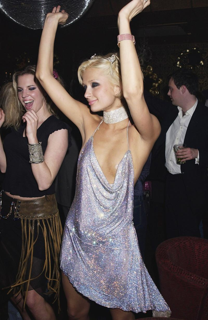 Paris Hilton celebrates her 21st Birthday Party at the Stork Rooms in London wearing a chainmail halter dress and rhinestone choker necklace.