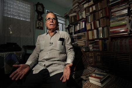 Cuban economist and former prisoner Oscar Espinosa Chepe talks to Reuters during an interview in Havana