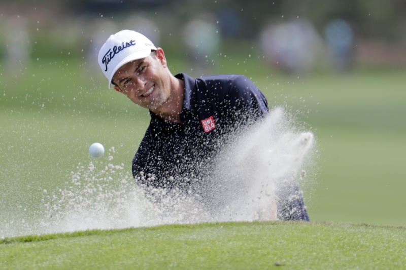 Adam Scott, of Australia, hits from a bunker on the ninth hole during a practice round for The Players Championship golf tournament, Wednesday, March 11, 2020, in Ponte Vedra Beach, Fla. (AP Photo/Lynne Sladky)
