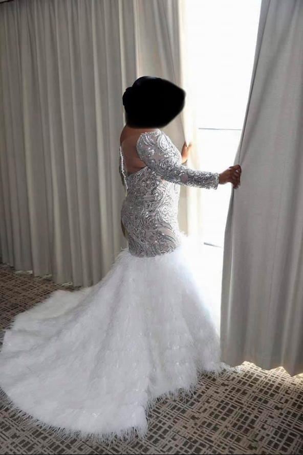 Bride in feathered wedding dress