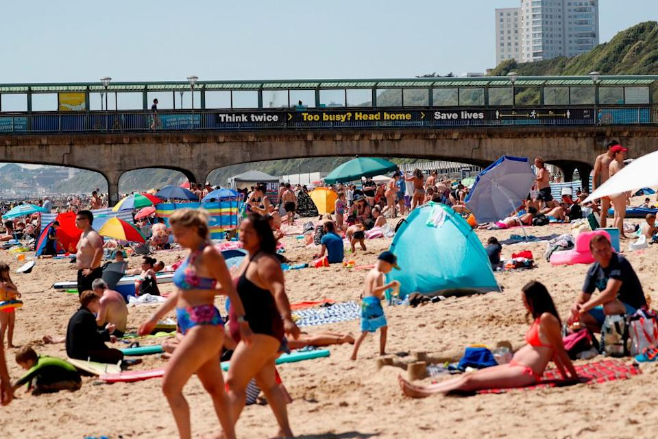 The world was shocked by photos of Bournemouth beach in the UK as the virus still circulated in the community last year. Source: Getty