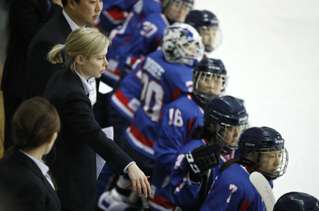 Combined Koreas head coach Sarah Murray (L) watches a women's ice hockey friendly game between her team and Sweden at Seonhak International Ice Rink in Incheon, South Korea. (AP)
