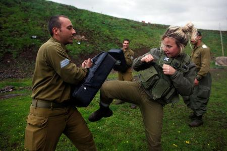A female Israeli soldier from the Haraam artillery battalion takes part in a training session in Krav Maga, an Israeli self-defence technique, at a military base in the Israeli-occupied Golan Heights