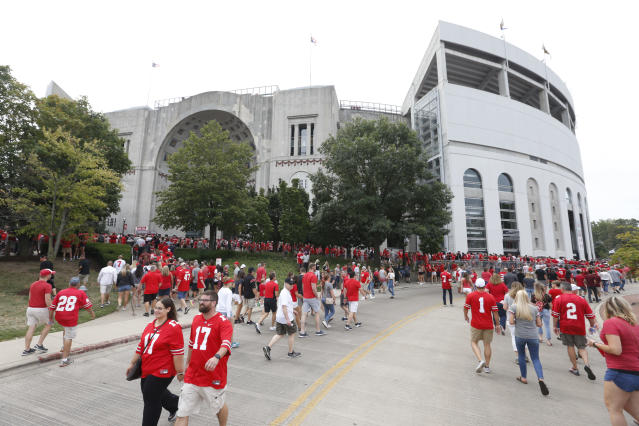 Fans are seen outside of Ohio Stadium before an NCAA football game against Florida Atlantic on Saturday, Aug. 31, 2019 in Columbus, Ohio. (AP Photo/Paul Vernon)
