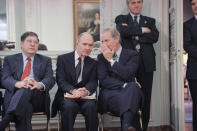 FILE - In this Nov. 21, 1990 file photo, Secretary of State James Baker whispers to National Security Advisor Brent Scowcroft during an impromptu press conference by President George H. W. Bush in Paris. At left is White House Chief of Staff John Sununu. A longtime adviser to Presidents Gerald Ford and George H.W. Bush has died. Brent Scowcroft was 95. A spokesperson for the late President Bush says Scowcroft died Thursday of natural causes at his home in Falls Church, Virginia.(AP Photo/Scott Applewhite)