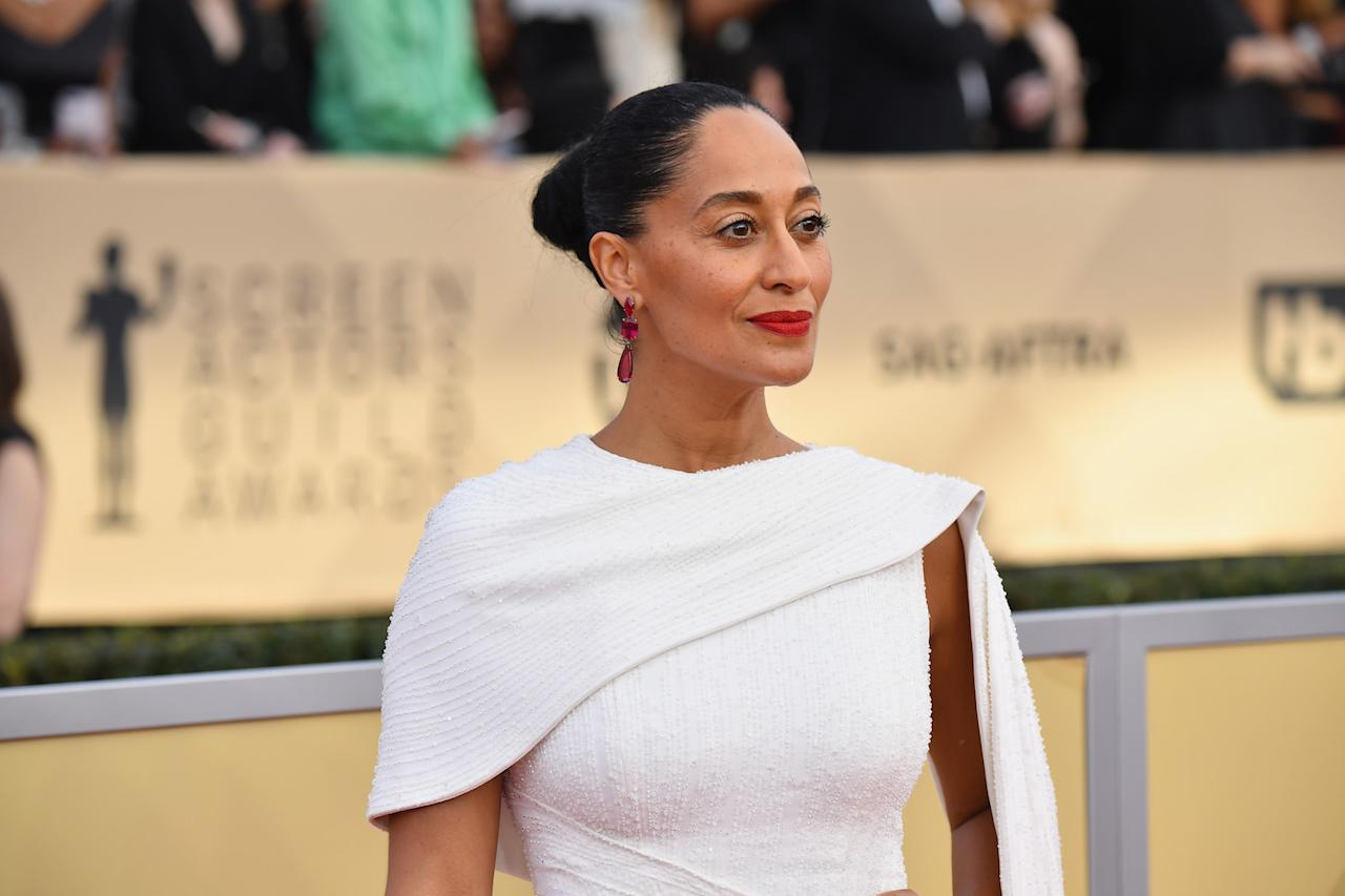 "<p>It's no secret that Tracee Ellis Ross is a fan of a bold red lip. Copy her look by swiping <a rel=""nofollow"" href=""https://www.sephora.com/product/le-marc-lip-creme-P392352?skuId=1651330"">Marc Jacobs Beauty Le Marc Lip Crème Lipstick in Dashing 206</a> on your lips for a powerful pout. (Photo: Getty Images) </p>"