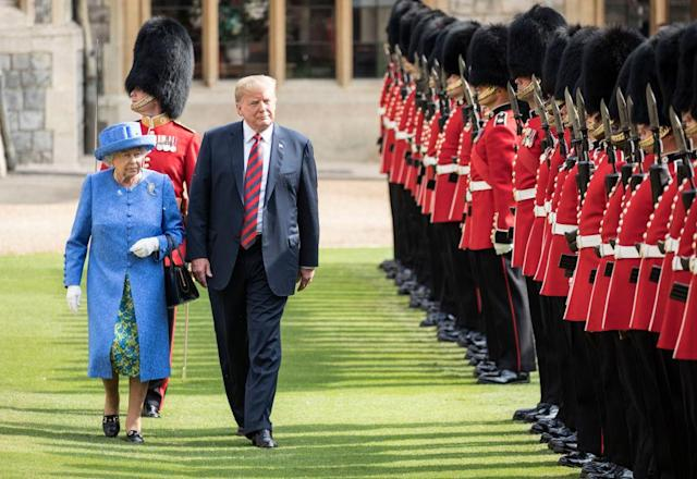 The queen walks with President Trump as they inspect the Coldstream Guards at Windsor Castle. (Photo: Getty Images)