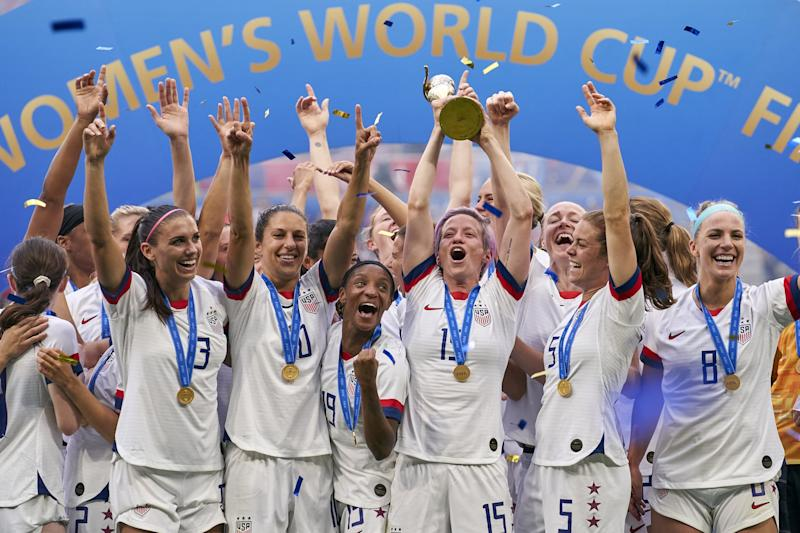 LYON, FRANCE - JULY 07: Team USA celebrates with the FIFA Womens world cup trophy at full time of the 2019 FIFA Women's World Cup France Final match between Winner The United States of America and Netherlands at Stade de Lyon on July 7, 2019 in Lyon, France.. (Photo by Quality Sport Images/Getty Images)