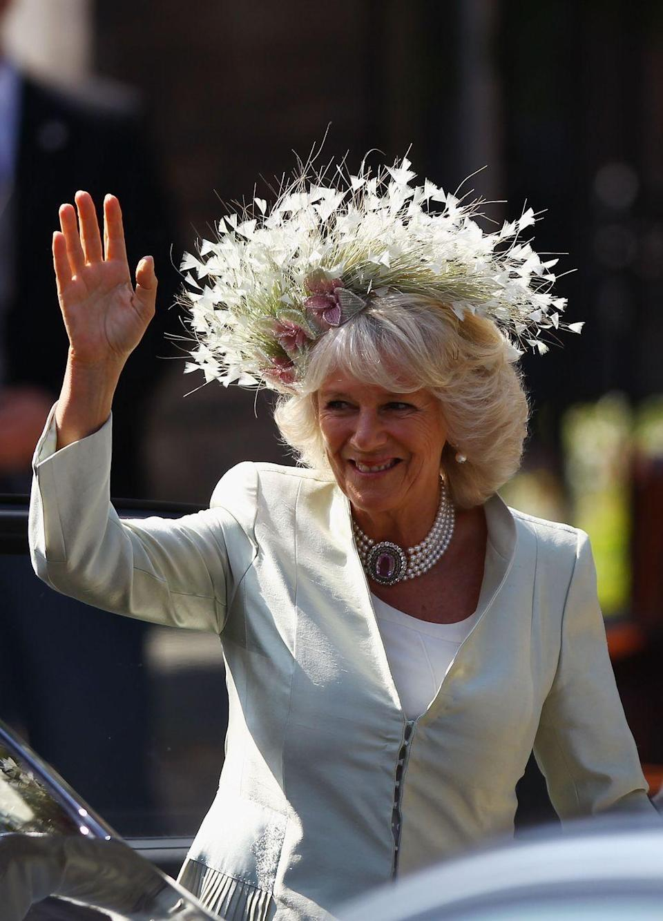 <p>Now that's a headpiece. Camilla went all out with a floral design for Zara's wedding.</p>