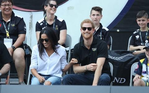 Prince Harry and Meghan Markle at the wheelchair tennis - Credit: Stephen Lock/i-Images