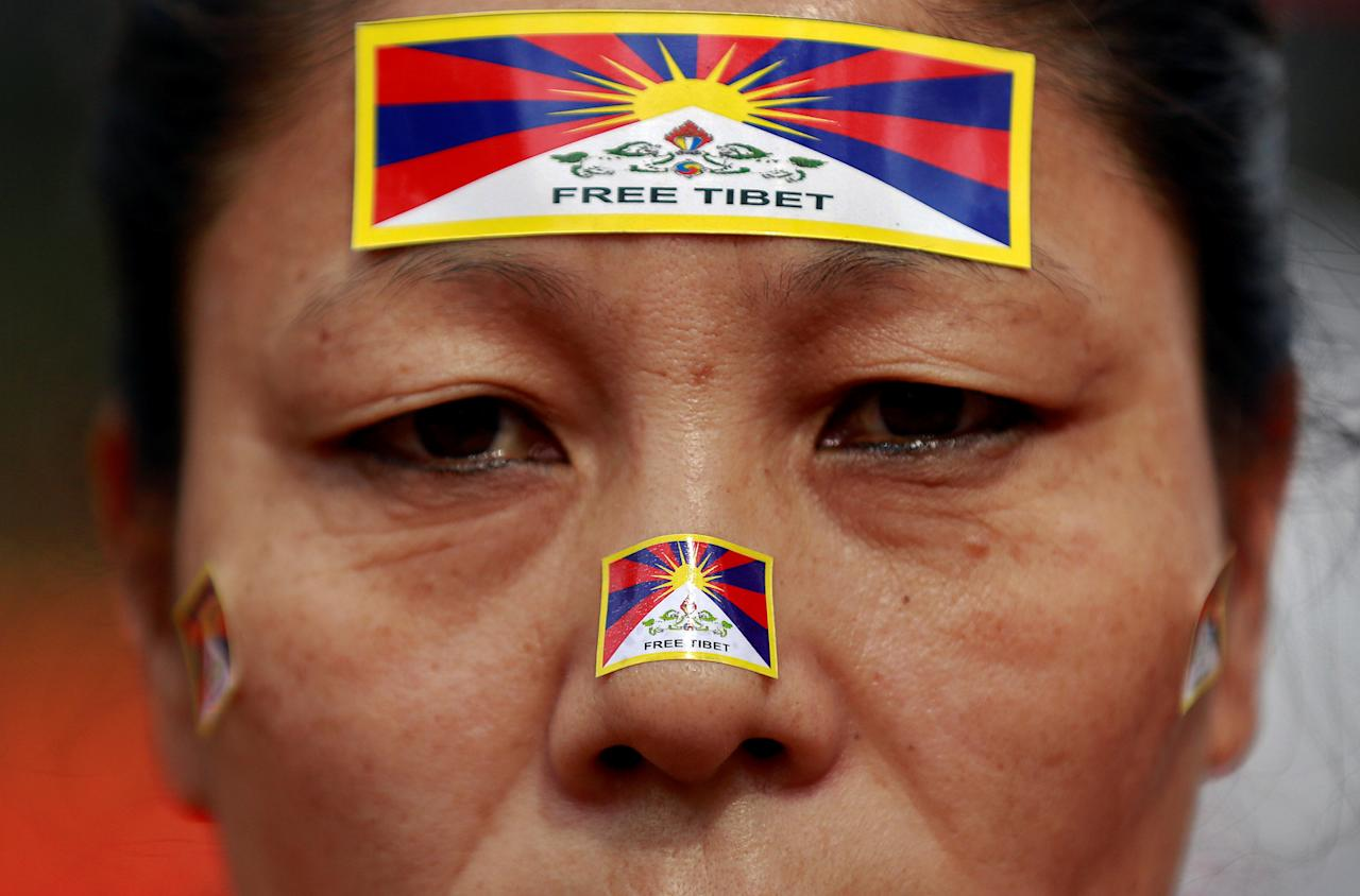<p>A Tibetan woman attends a protest held to mark the 10th anniversary of a Tibetan uprising against Chinese rule, in New Delhi, India, March 14, 2018. REUTERS/Cathal McNaughton </p>