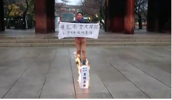 Alex Kwok protests at the shrine last December. Photo: Facebook