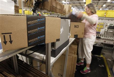 Worker prepares an item for delivery at Amazon's distribution center in Phoenix