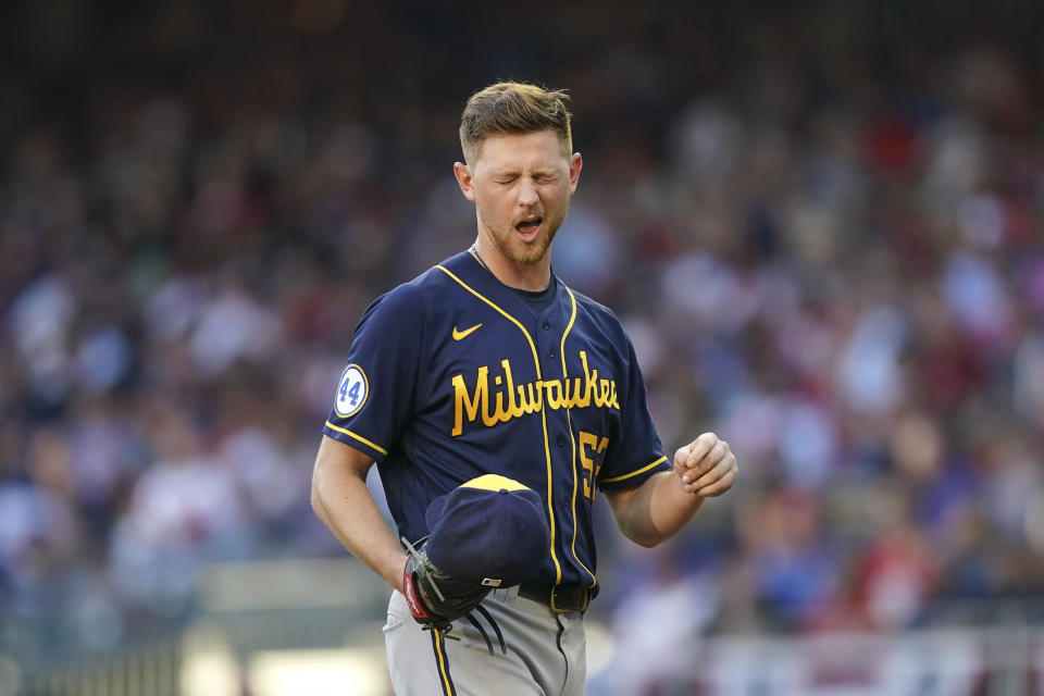 Milwaukee Brewers starting pitcher Eric Lauer (52) pauses with an eye problem against the Atlanta Bravesduring the third inning of Game 4 of a baseball National League Division Series, Tuesday, Oct. 12, 2021, in Atlanta. (AP Photo/Brynn Anderson)
