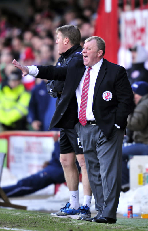 "Crawley Town's Scottish manager Steve Evans gestures during the FA Cup fifth round football match against Stoke City at Broadfield Stadium in Crawley, on February 19, 2012.                                                                                                                RESTRICTED TO EDITORIAL USE. No use with unauthorized audio, video, data, fixture lists, club/league logos or ""live"" services. Online in-match use limited to 45 images, no video emulation. No use in betting, games or single club/league/player publications. (Photo by Glyn Kirk/AFP/Getty Images)"