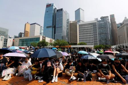 Students stage a rally to call for political reforms outside City Hall in Hong Kong