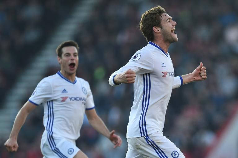 Chelsea's  Marcos Alonso (R) celebrates scoring their third goal from a free kick during their match against Bournemouth at the Vitality Stadium in Bournemouth, southern England on April 8, 2017