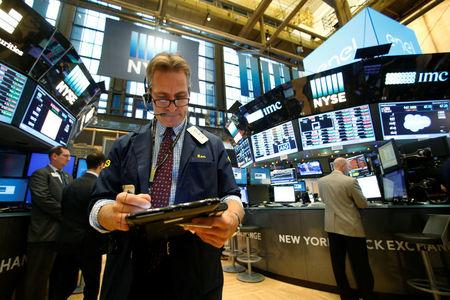 Traders work on the floor of the NYSE in New York City