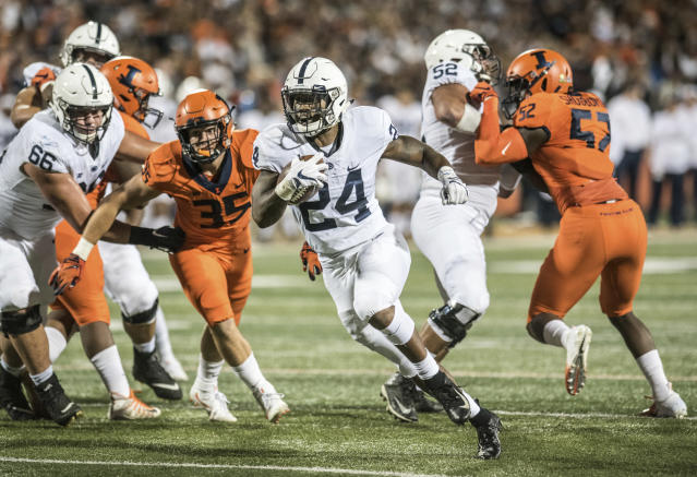 Penn State running back Miles Sanders (24) finds a hole in the first quarter against Illinois during an NCAA college football game Friday, Sept. 21, 2018, in Champaign, Ill. (AP Photo/Holly Hart)