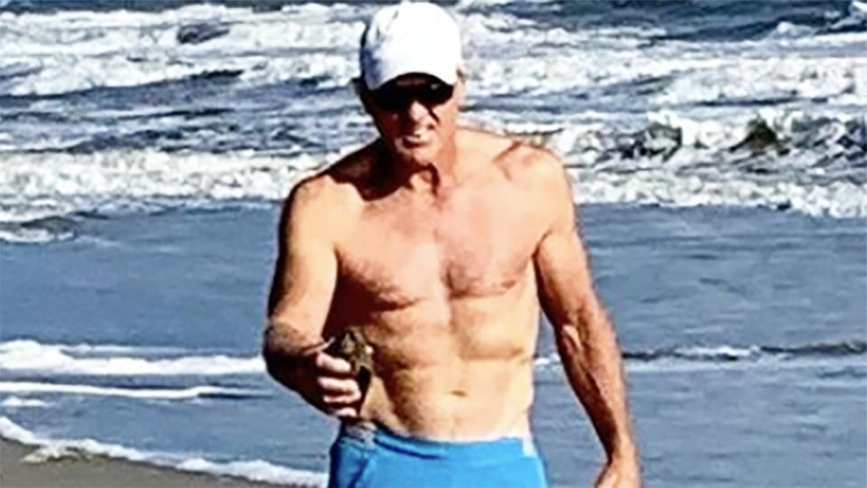 Greg Norman, pictured here at the beach with his dog.