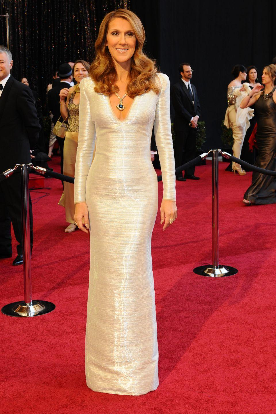 <p>In a sparkling white gown and massive emerald and diamond necklace at the Academy Awards. </p>
