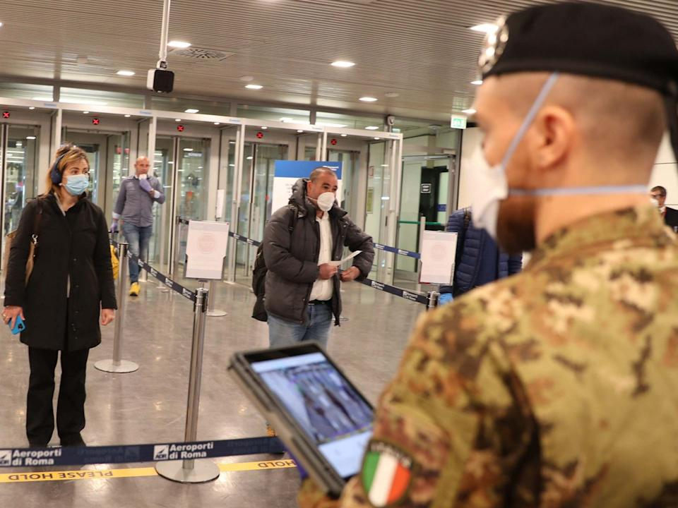 Thermal cameras monitors are used to check the body temperature of passengers at Fiumicino airport, near Rome, Italy: EPA